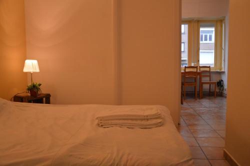 Ein Bett oder Betten in einem Zimmer der Unterkunft Bruges Blankenberge Coast Condo
