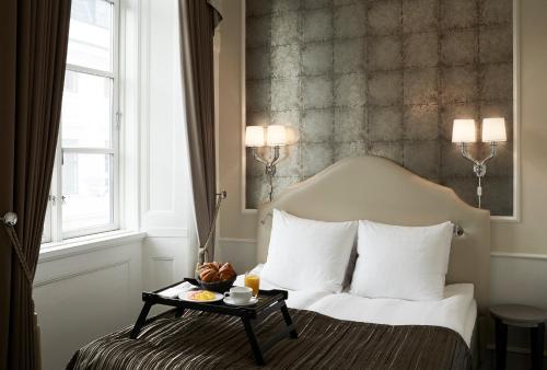 Кровать или кровати в номере Phoenix Copenhagen