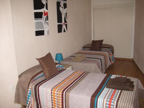 A bed or beds in a room at La Casa de Lara
