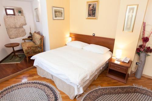 Krevet ili kreveti u jedinici u objektu Hotel Peristil