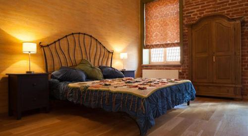 A bed or beds in a room at Luxury Kaunas Old Town Apartment