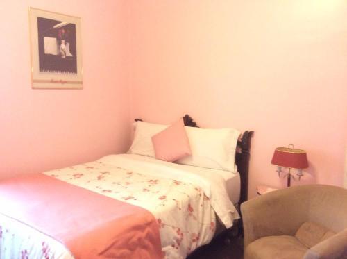 Un ou plusieurs lits dans un hébergement de l'établissement La Maison Demers
