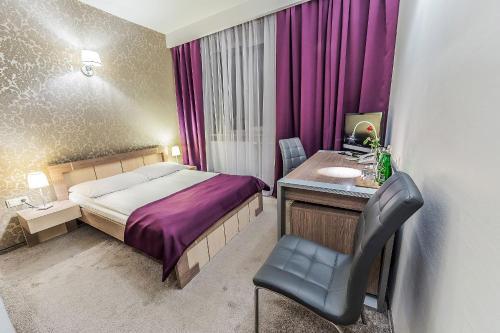 Łóżko lub łóżka w pokoju w obiekcie Hotel TM