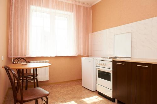 A kitchen or kitchenette at Granit Hotel