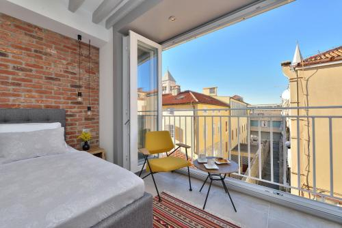 A balcony or terrace at Apartments & Rooms Mareta Exclusive