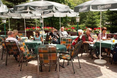 Ein Restaurant oder anderes Speiselokal in der Unterkunft Waldhotel Rennsteighof