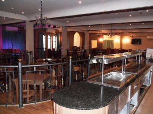 A restaurant or other place to eat at Skylark Hotel