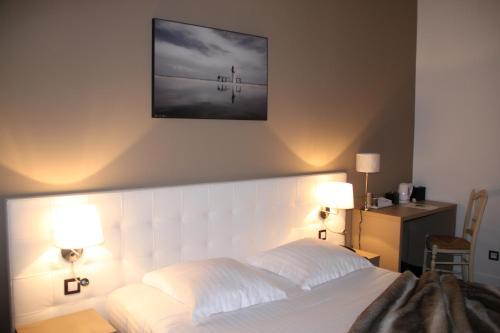 Un ou plusieurs lits dans un hébergement de l'établissement Le Saint Louis