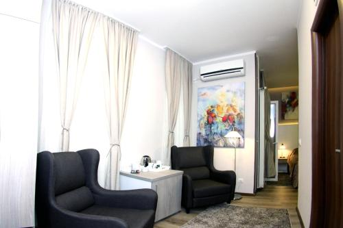 A seating area at Gala Luxury Suites