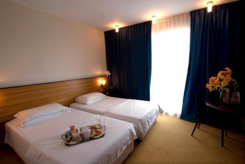 Кровать или кровати в номере Nicotel Corato