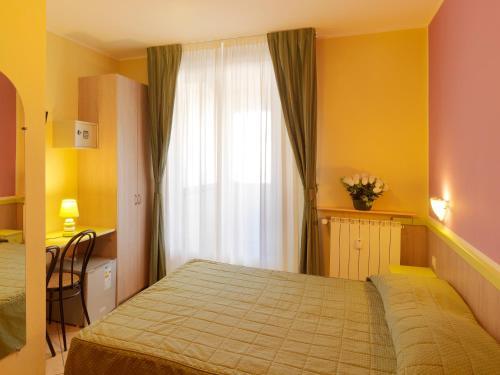 Кровать или кровати в номере Hotel Arco Romana