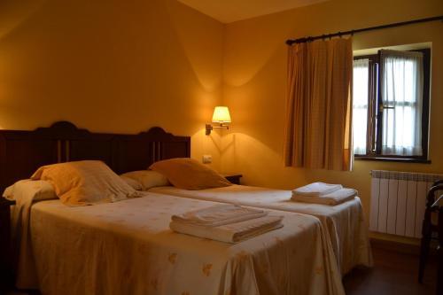 Cama o camas de una habitación en La Fonte