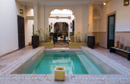The swimming pool at or near Riad 5 Sens