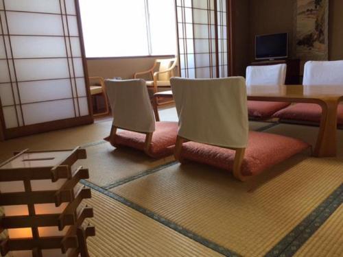 A seating area at Hotel Tetora Resort Tsuruoka