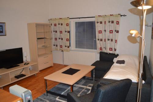 Гостиная зона в Vardø Apartments