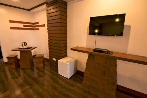 A television and/or entertainment centre at Abozza Resort
