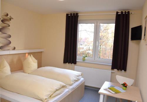 Ein Bett oder Betten in einem Zimmer der Unterkunft Villa Ephraim