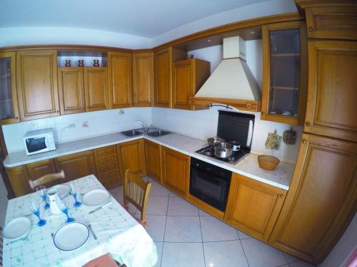 Kuchyň nebo kuchyňský kout v ubytování Appartamenti Ponente