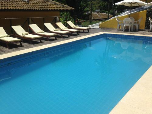 The swimming pool at or near Areia Branca Apart Hotel