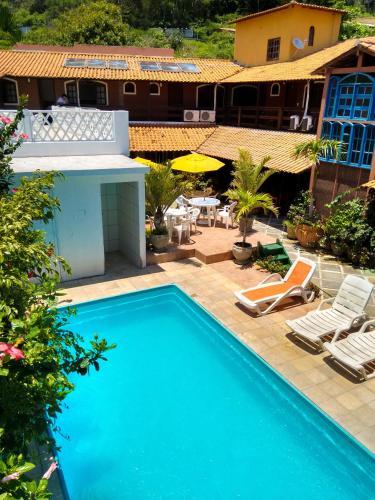 A piscina localizada em Pousada Porto Praia ou nos arredores