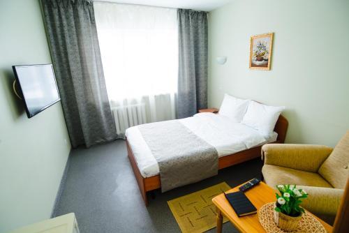 Кровать или кровати в номере Гостиница Алгоритм