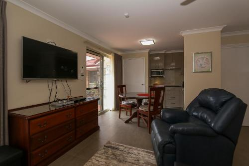 A television and/or entertainment center at The Good Life B&B