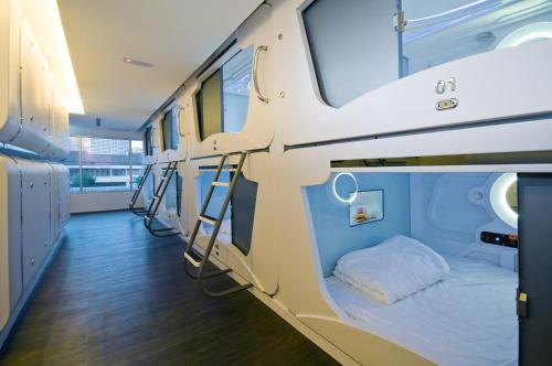 A bunk bed or bunk beds in a room at M Qube Hotel