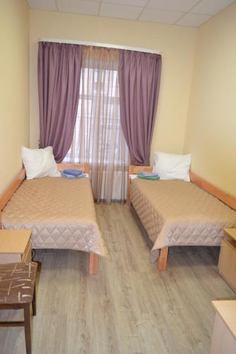 A bed or beds in a room at Zvenigorodskaya
