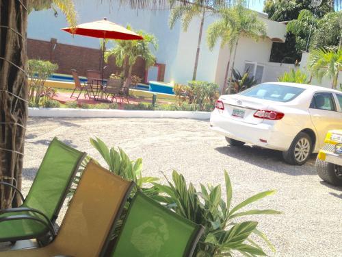 The swimming pool at or near Hotel y Suites Los Encantos