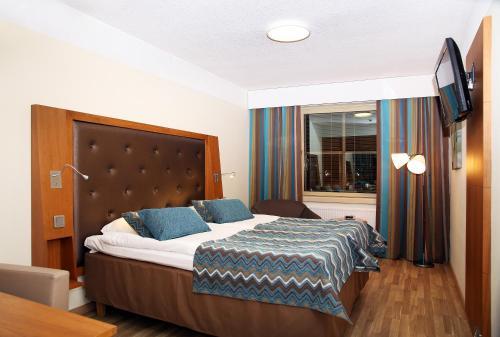 Säng eller sängar i ett rum på Hotel Vallonia