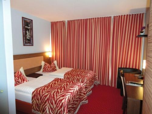 A bed or beds in a room at Grand Hotel Dream Main City Center