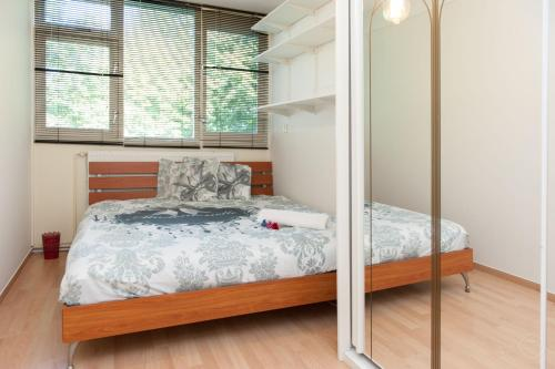 A bed or beds in a room at North Apartment Amsterdam