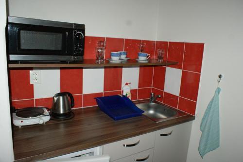 A kitchen or kitchenette at Apartmá Lipno