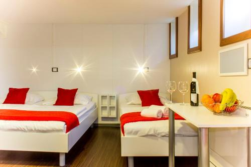 A bed or beds in a room at Botel Marina