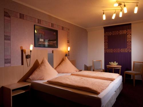 Ein Bett oder Betten in einem Zimmer der Unterkunft Beim Weinbauer