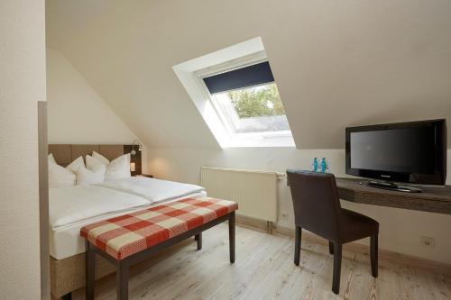 Ein Bett oder Betten in einem Zimmer der Unterkunft H+ Hotel Nürnberg