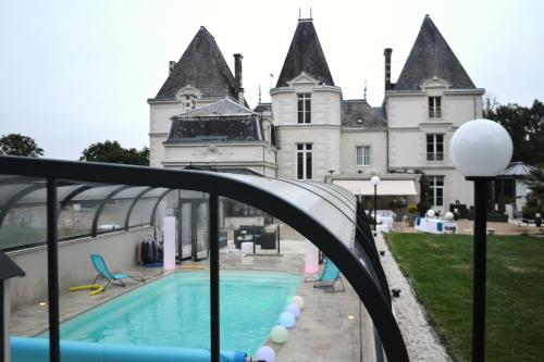 The swimming pool at or near Le Domaine du Chêne Vert