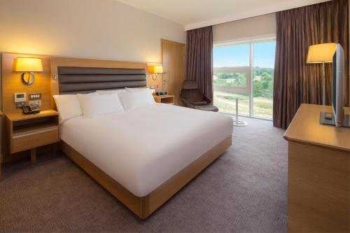 A bed or beds in a room at Hilton at St George's Park