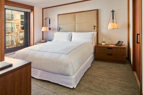 Cama ou camas em um quarto em The Clement Hotel - All Inclusive