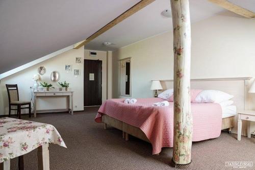 Łóżko lub łóżka w pokoju w obiekcie Gościniec Winnica