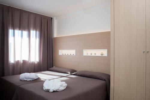 Cama o camas de una habitación en Aparthotel Acualandia