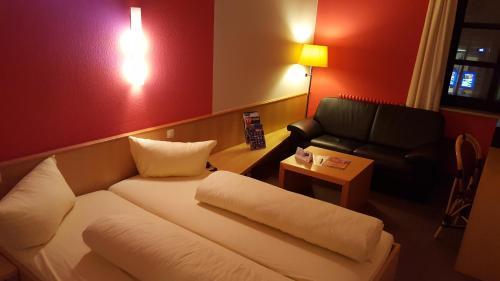 Ein Sitzbereich in der Unterkunft Meister BÄR HOTEL Wunsiedler Hof