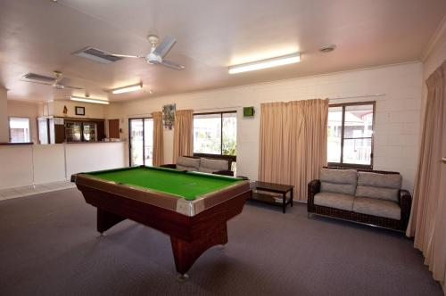 A pool table at The Swagmans Rest Apartments