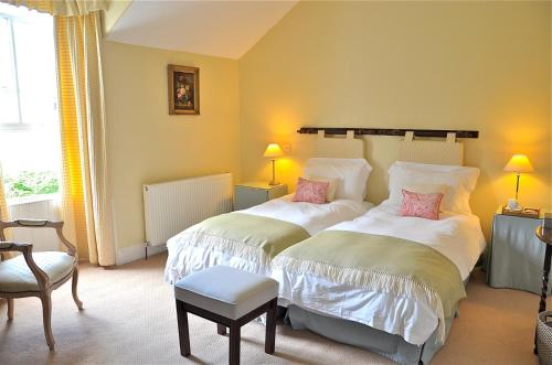A bed or beds in a room at Kilfinan Hotel