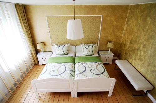 Ein Bett oder Betten in einem Zimmer der Unterkunft B&B EMG