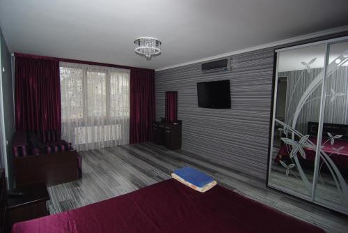 A television and/or entertainment center at Guest House Belaiya Magnolia