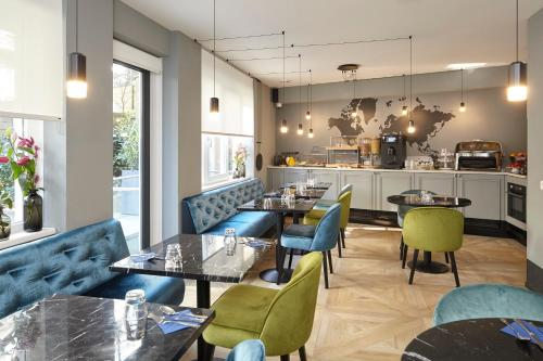 A restaurant or other place to eat at The Muse Amsterdam - Boutique Hotel