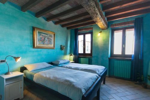Letto o letti in una camera di Villa Gaia