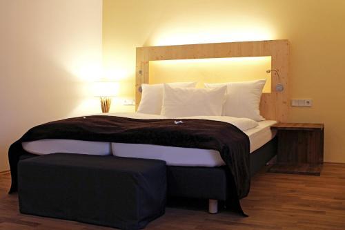 Кровать или кровати в номере GROSCH Brauhotel & Gasthof