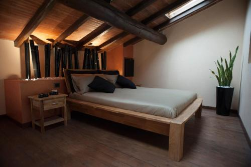 A bed or beds in a room at Agriturismo Corte Acconi